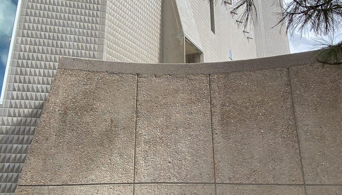 View of decorative concrete retaining walls next to Denver Art Museum with beautiful texture.