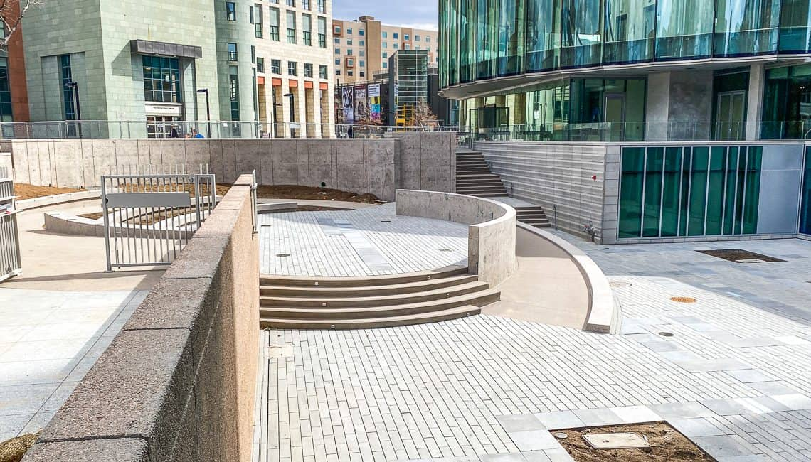 Wide view of Denver Art Museum courtyard including many decorative concrete features all completed by Colorado Hardscapes.