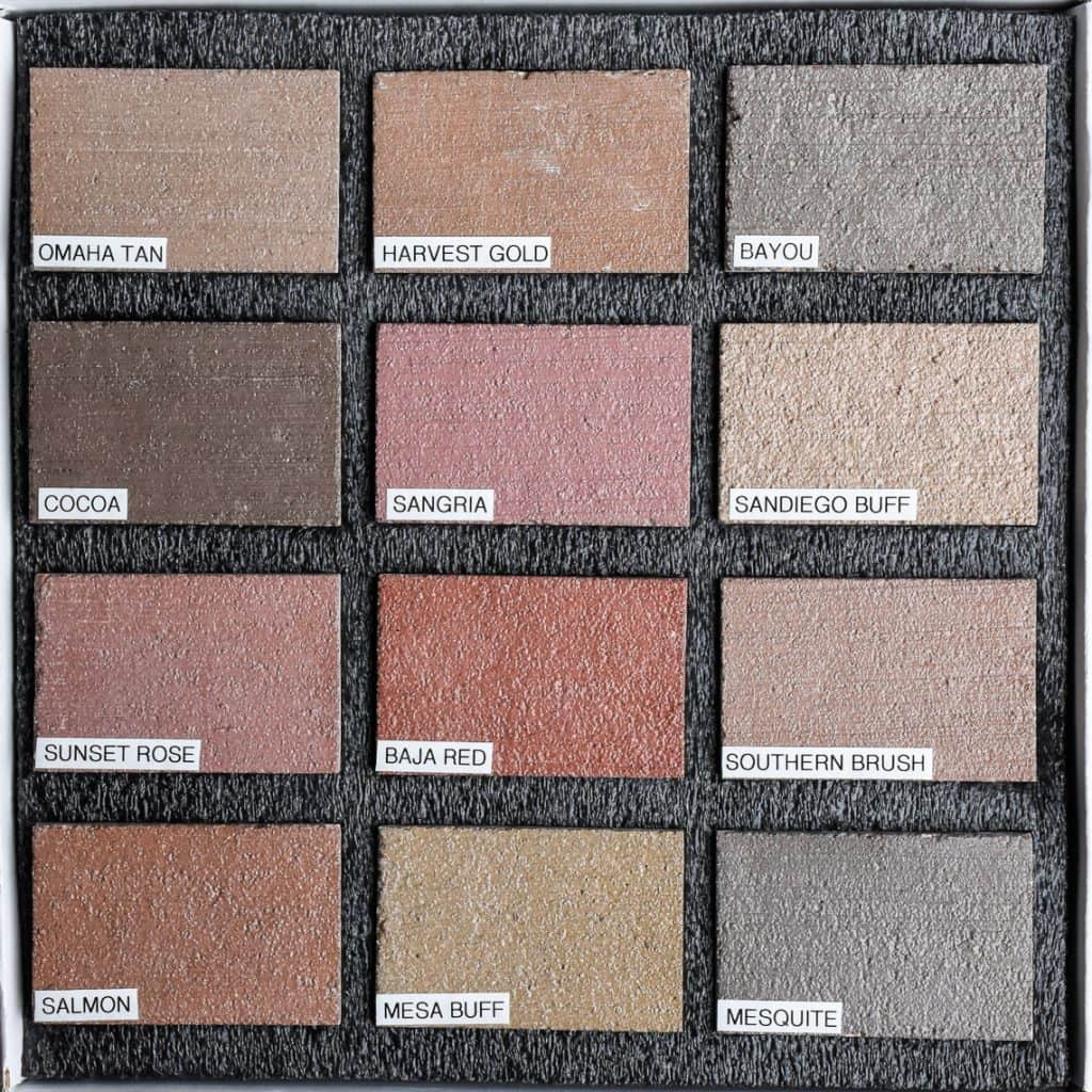 Sample box of twelve color hardener decorative concrete samples with labels from Colordao Hardscapes beautiful muted and natural color options.