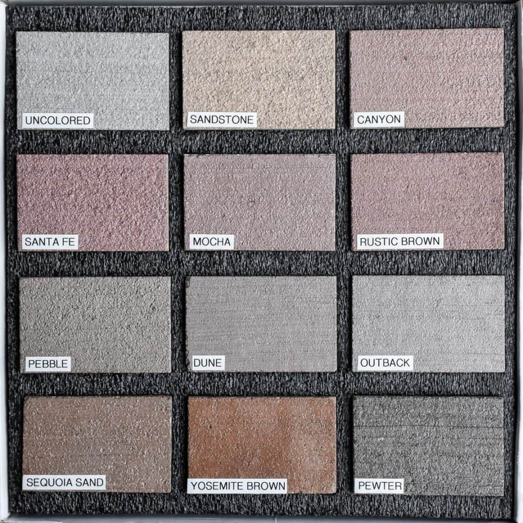 Sample box of twelve color hardener decorative concrete samples with labels from Colordao Hardscapes beautiful pale colors and gray options.