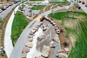 Drone view of strem bed with lithocrete and natural boulders in neighborhood in Colorado.