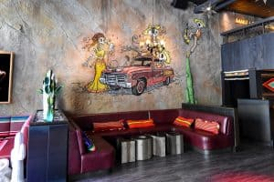 Artistic concrete wall veneer on Otra Vez Cantina wall is all about aesthetics.