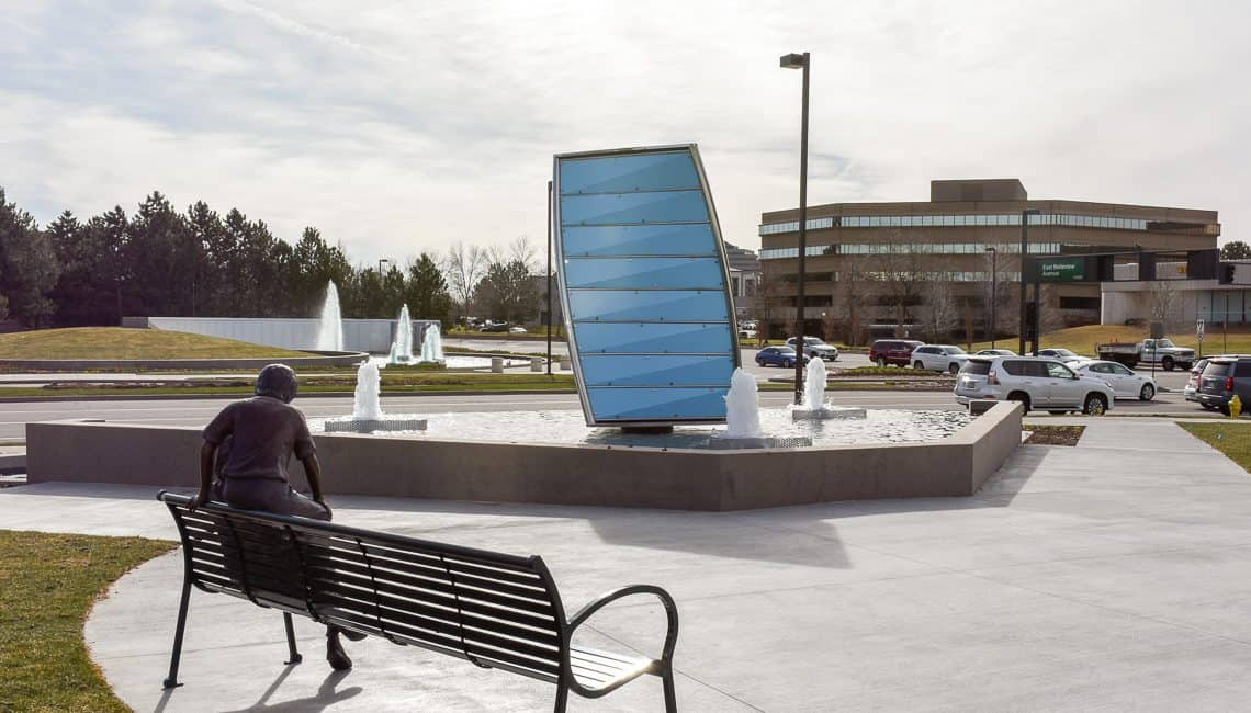 Denver Tech Center water feature with three geyser nozzles and a large prism centerpiece.
