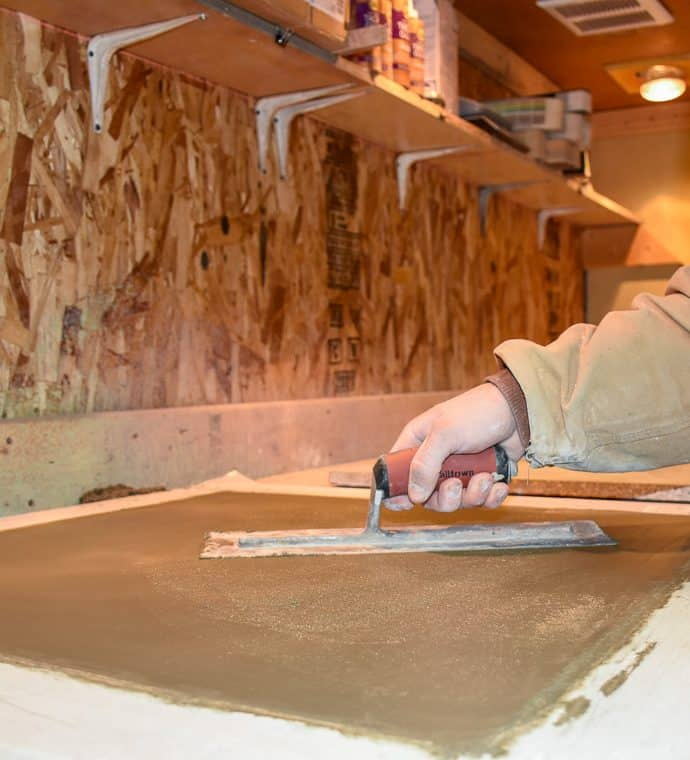 Our concrete sample maker troweling a concrete sample for a client in our sample bay.