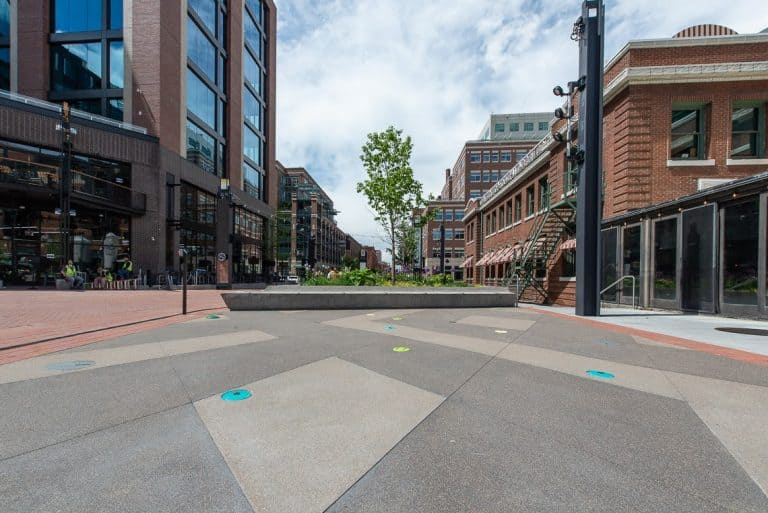 McGregor Square Sandscape pop jet feature done by others next to polished concrete benches.