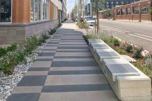 Denver Design District Apartments alternating con-colored Sandscape finished sidewalk with special scoring.