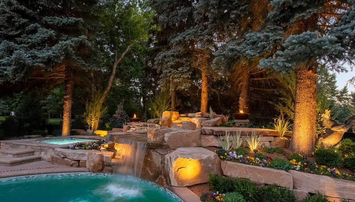 Dream backyard at private residence with sandstone waterfall and spa.