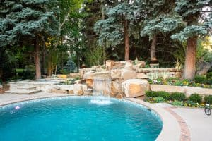 Dream backyard at private residence with 8x8 spa and sandstone waterfall.